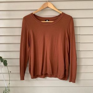 Burnt orange sweater with elbow pads